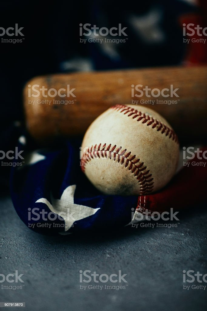 Sports Equipment. Baseball still life, worn ball with bat on American...