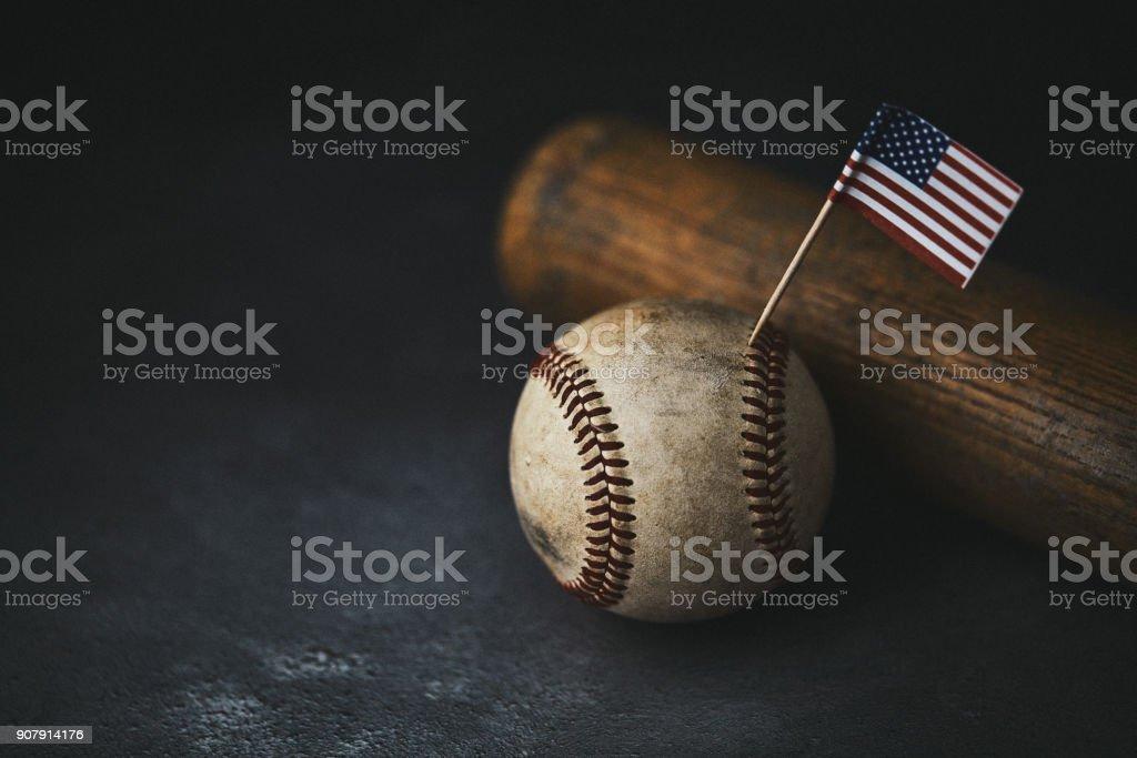 Sports Equipment. Baseball still life, worn ball with bat with...