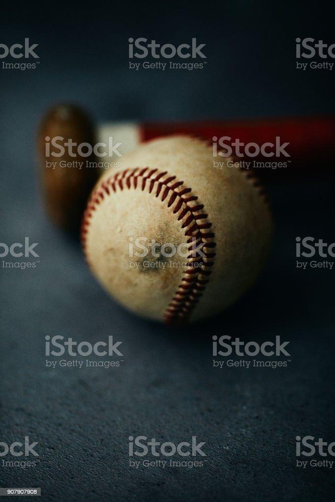 Sports Equipment. Baseball still life, worn ball with wooden bat