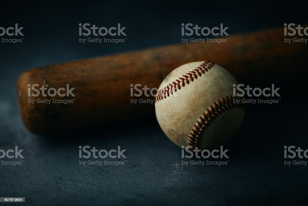 Sports Equipment. Baseball still life, worn ball with wooden bat
