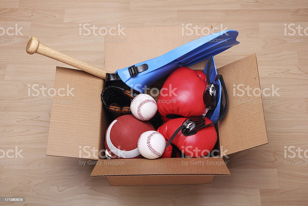 Sports equipment in a box royalty-free stock photo