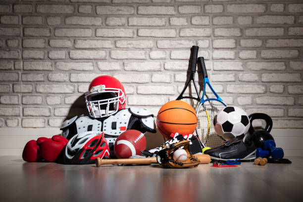 Sports Equipment On Floor Various Sport Equipment On Floor In Front Of Brick Wall sports stock pictures, royalty-free photos & images