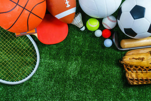Sports Equipment on green grass, Top view stock photo