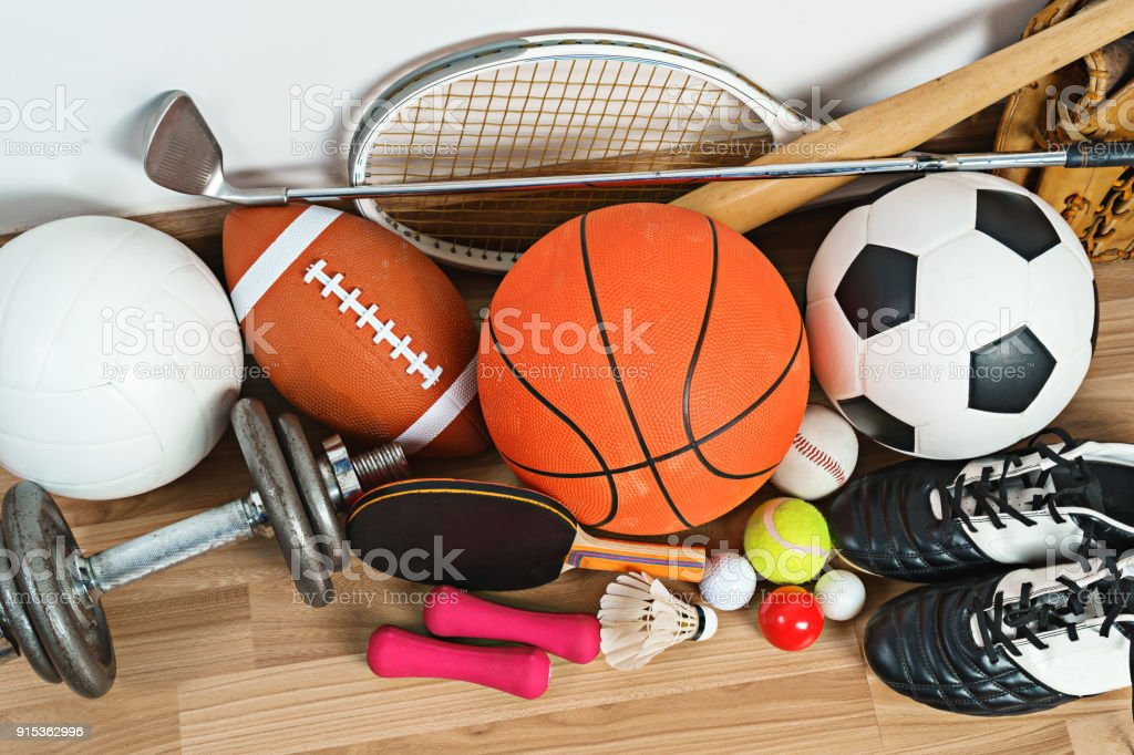 Sports Equipment on wooden background royalty-free stock photo