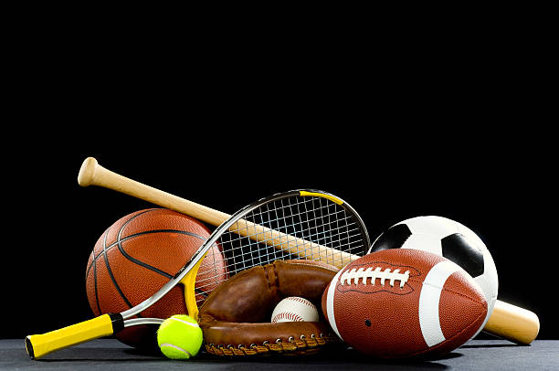 Sports equipment with rackets and balls Misc. Sports equipment on a black background with copy space above baseball sport stock pictures, royalty-free photos & images