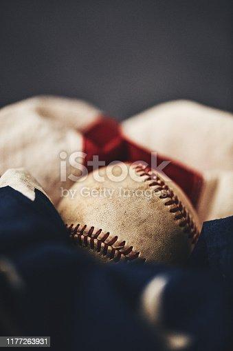 Sports Equipment. Worn baseball with American flag