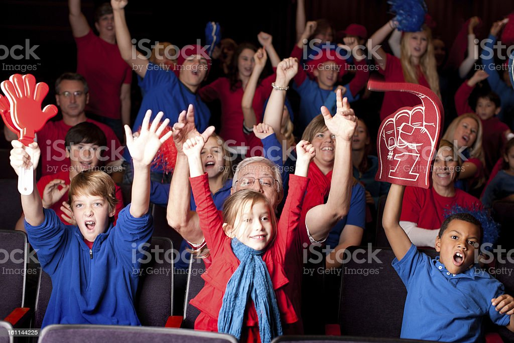 Sports Fans: Adults Children Excited Spectators Team Colors Red Blue royalty-free stock photo