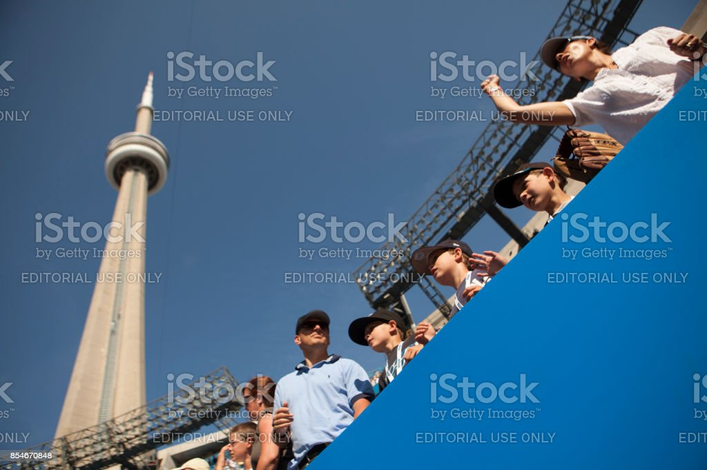 Sports fans at a baseball game under the CN Tower stock photo