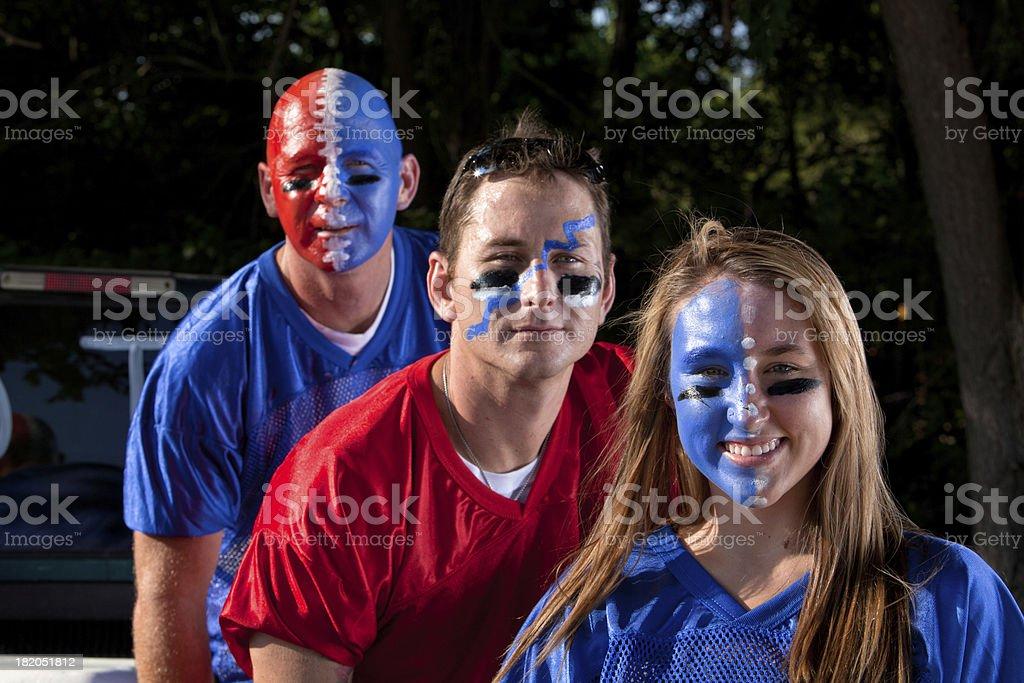 sports fans smiling at cameraChildren images