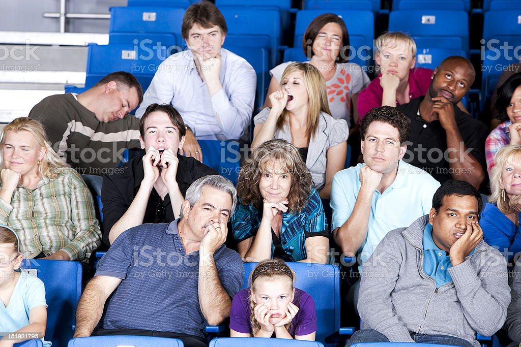 Sports Fans:  Bored Crowd Audience Stadium Sporting Event Mixed Race stock photo