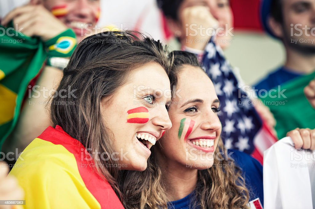 Sports fans cheering a game