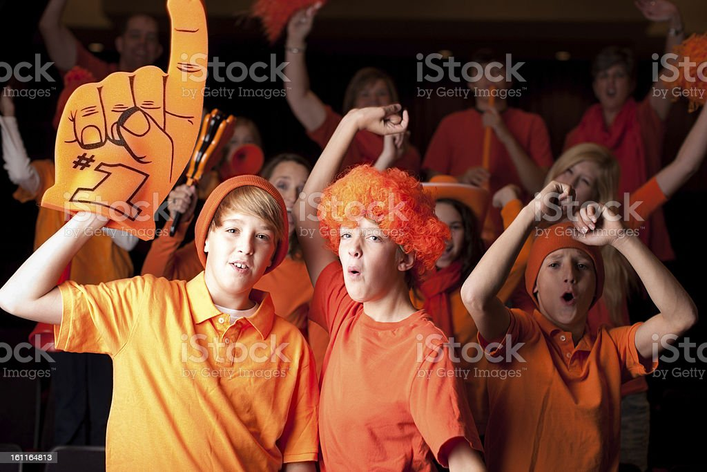 A group of real teenagers and children are enthusiastic sports fans...