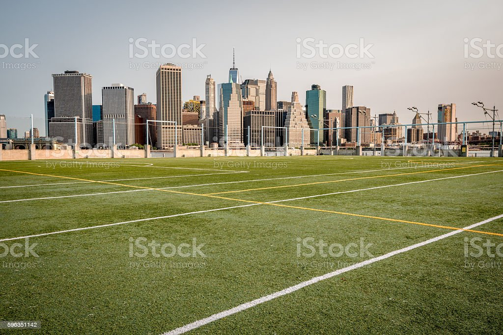 Sports field across from the New York city ckyline royalty-free stock photo