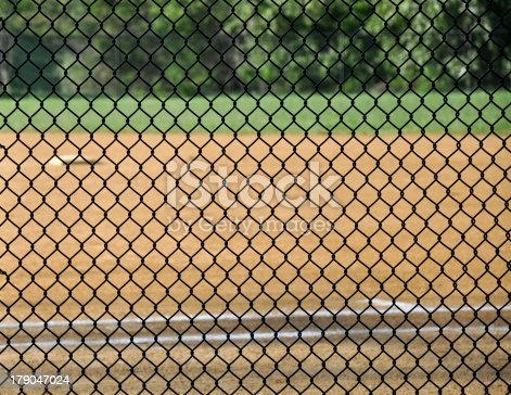 a wire fence on a baseball field