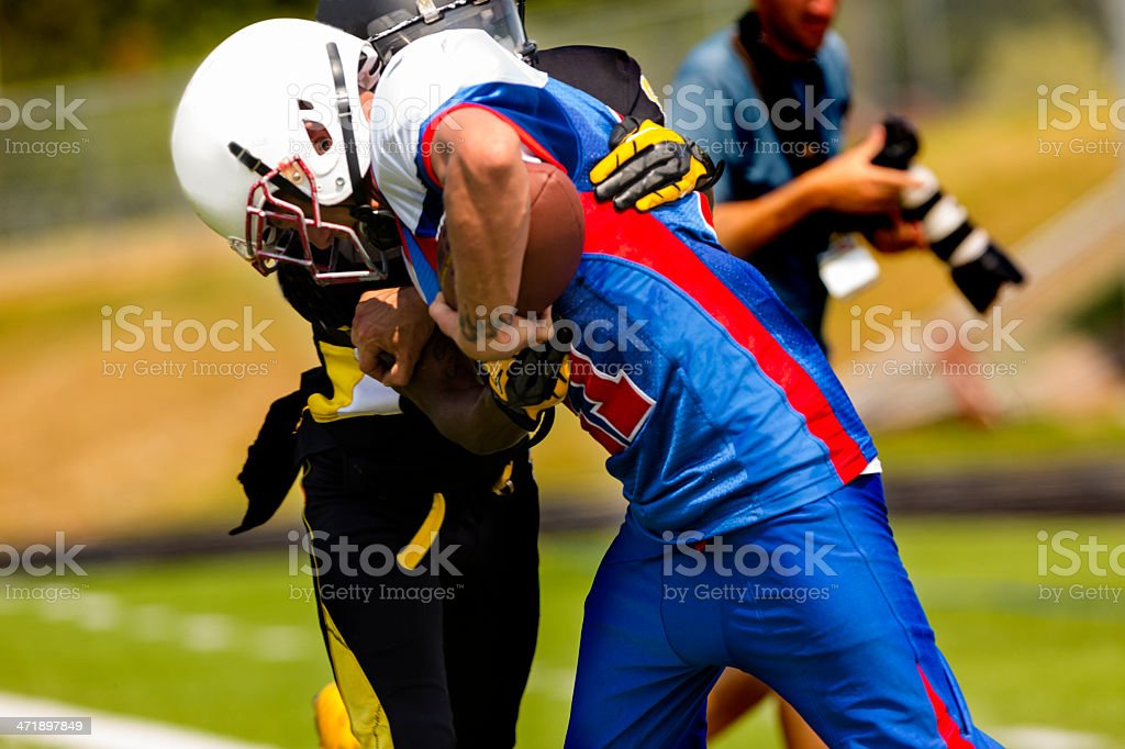 Sports:  Football running back carries the ball. stock photo