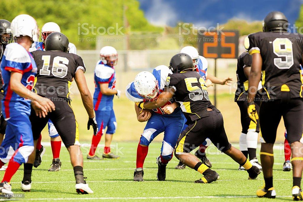 Sports:  Football running back makes a play. royalty-free stock photo