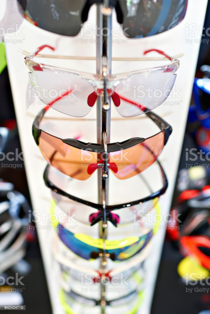 Sports glasses for cycling in storefront stock photo