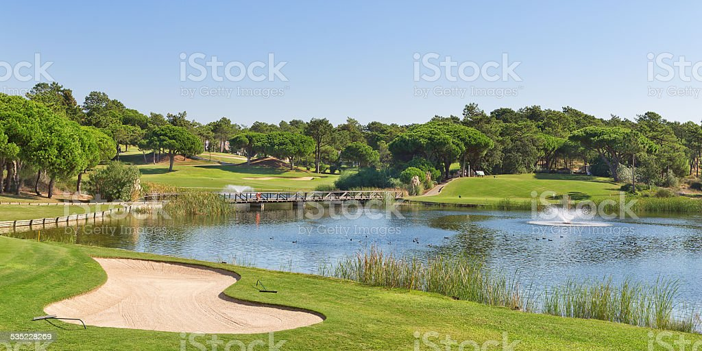 Sports golf park in Portugal. Near lake and fountain. stock photo