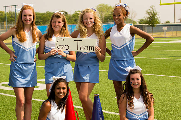 Sports:  Group of cheerleaders hold 'go team' sign. stock photo