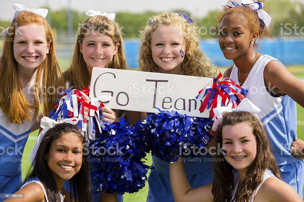 Sports:  Group of cheerleaders with 'go team' sign. stock photo