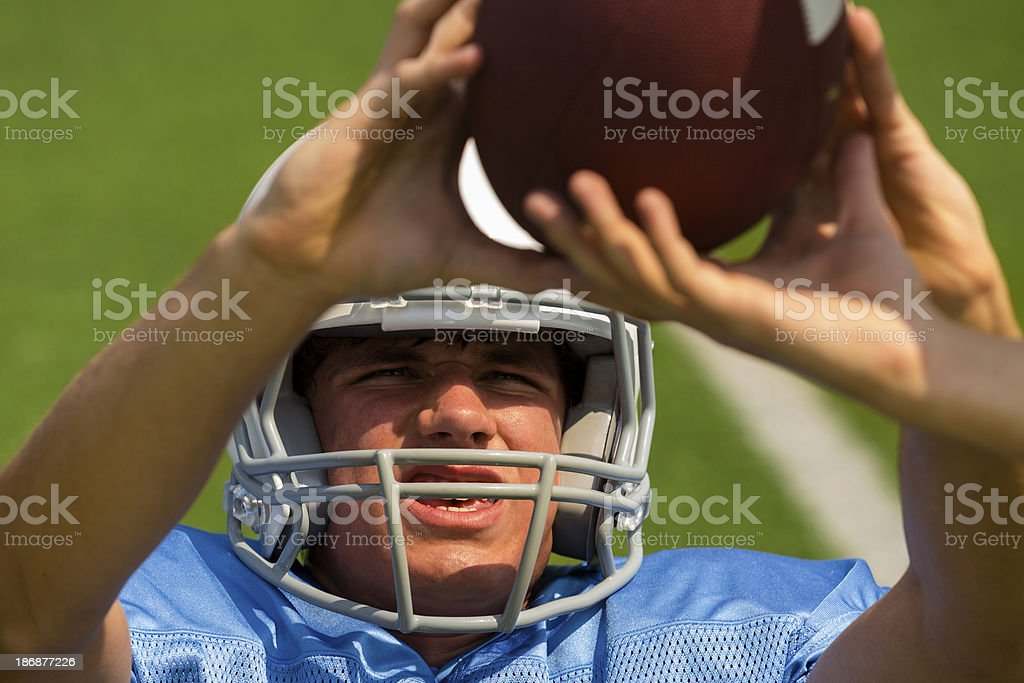 Sports:  HIgh school football player makes a catch. royalty-free stock photo