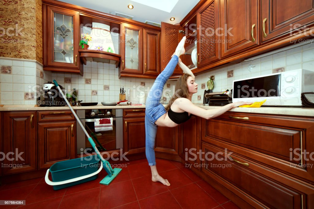 Sports housewives during cleaning. stock photo