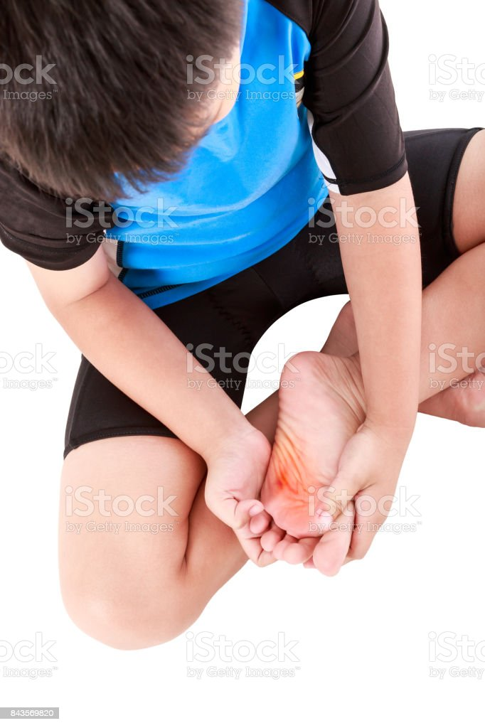 Sports injure. Asian child cyclist injured at sole of the foot. Isolated on white. stock photo