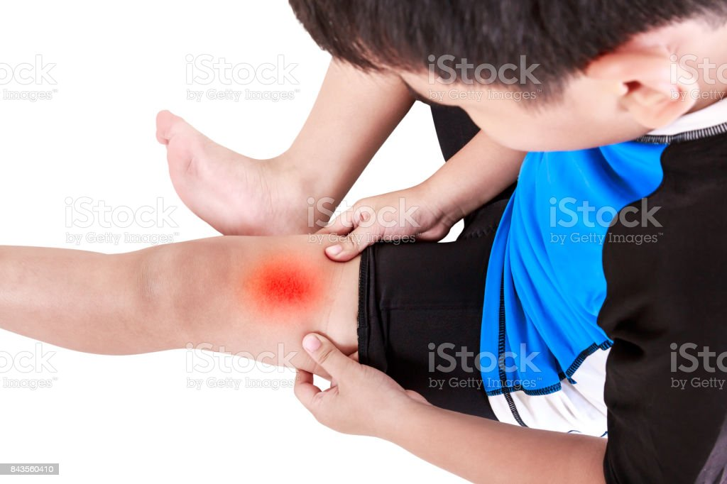 Sports injure. Asian child cyclist injured at thigh. Isolated on white. stock photo