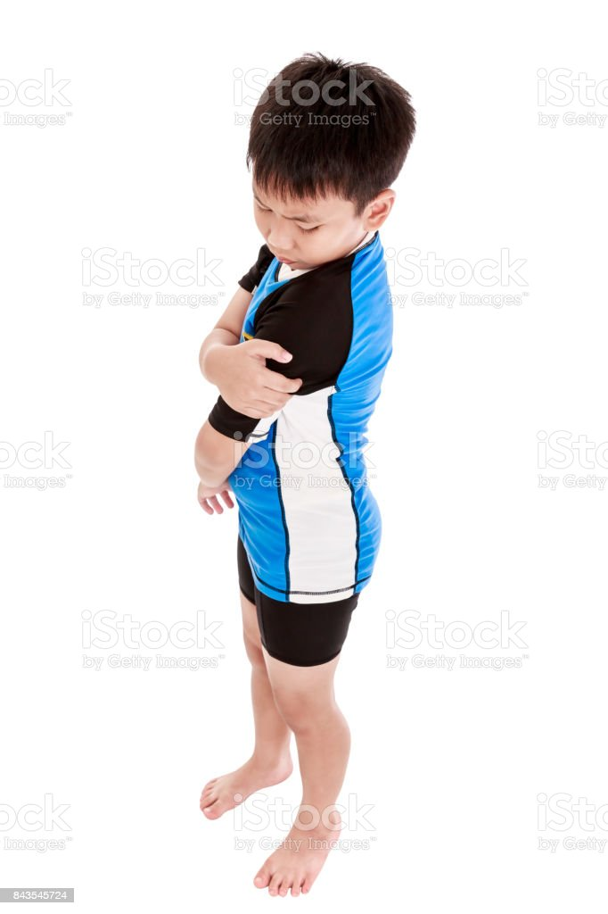 Sports injure. Asian child injured at shoulder. Isolated on white background. stock photo