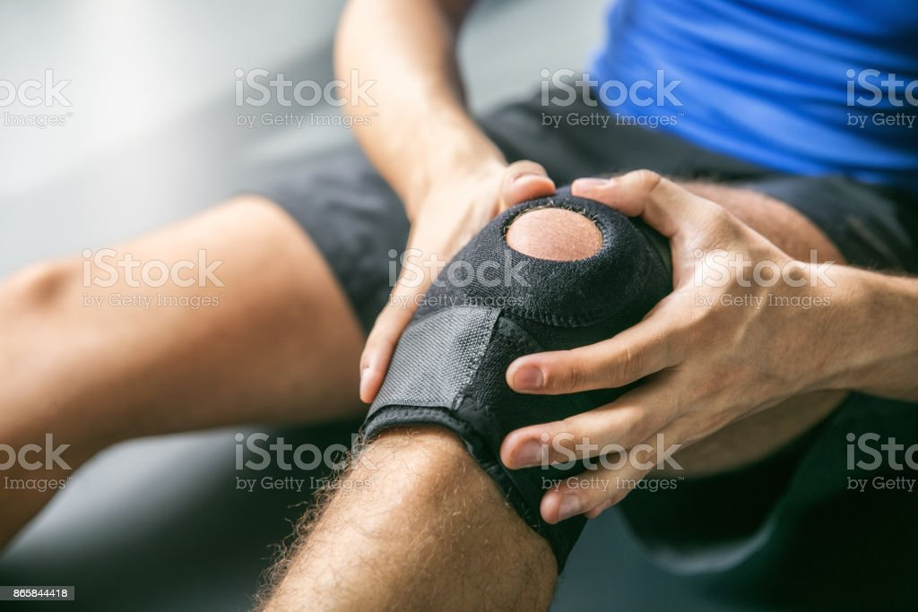 Sports injuries, bandaged knee stock photo