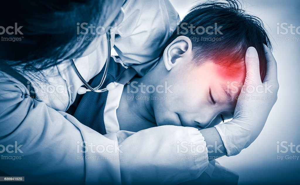Sports injury. Doctor give first aid at temple with bruise. stock photo