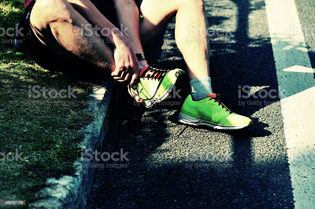 sports injury marathon runner roadside stock photo