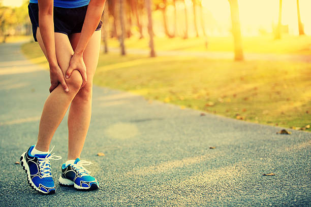sports  injury - human knee stock photos and pictures