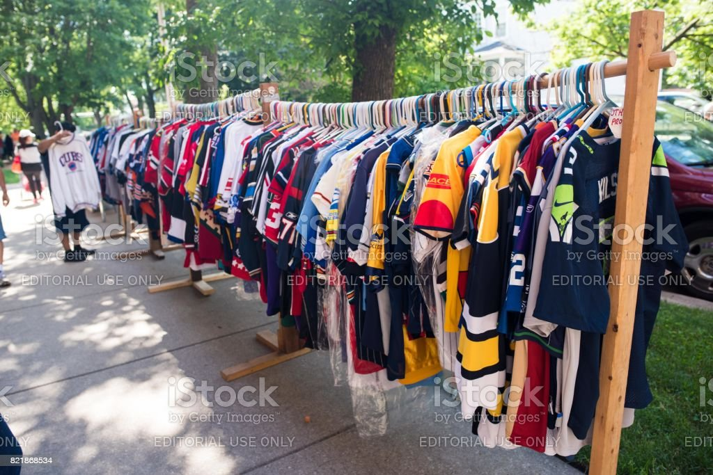 Sports jerseys for sale at a garage sale in Chicago stock photo