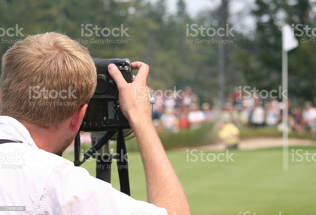 Sports Journalist Photographing Professional Golf Tournament stock photo