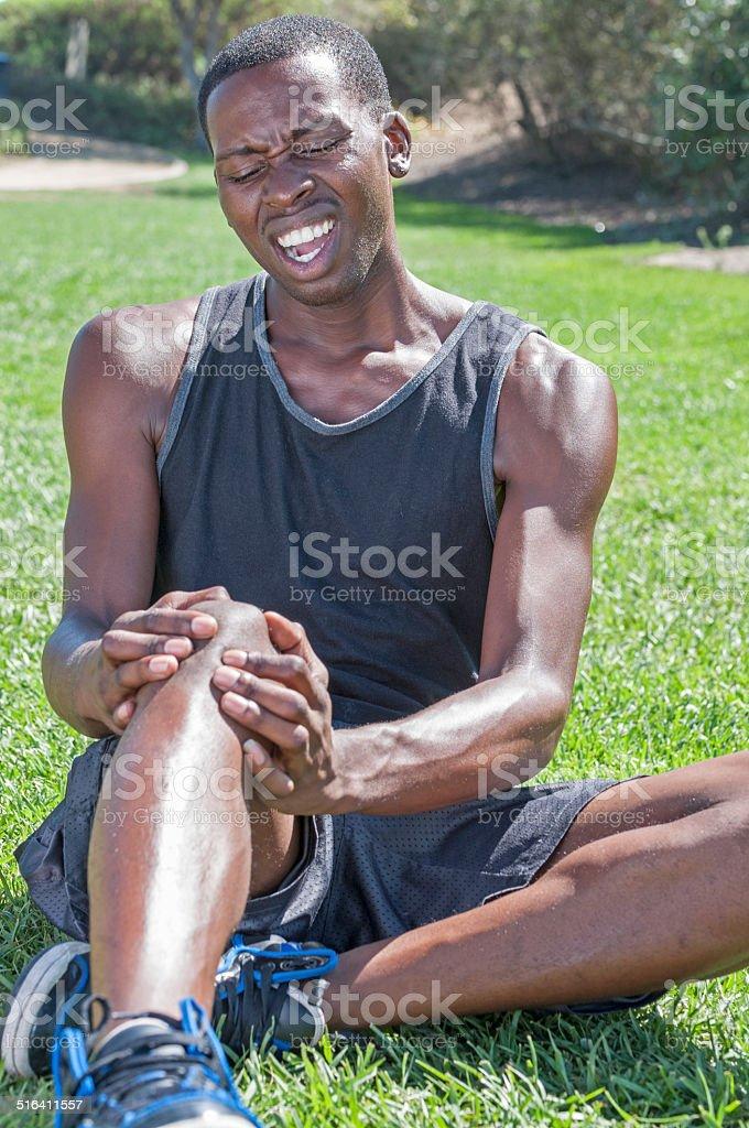 Sports knee injury stock photo