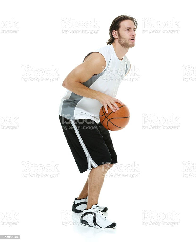 Sports man holding basketball stock photo