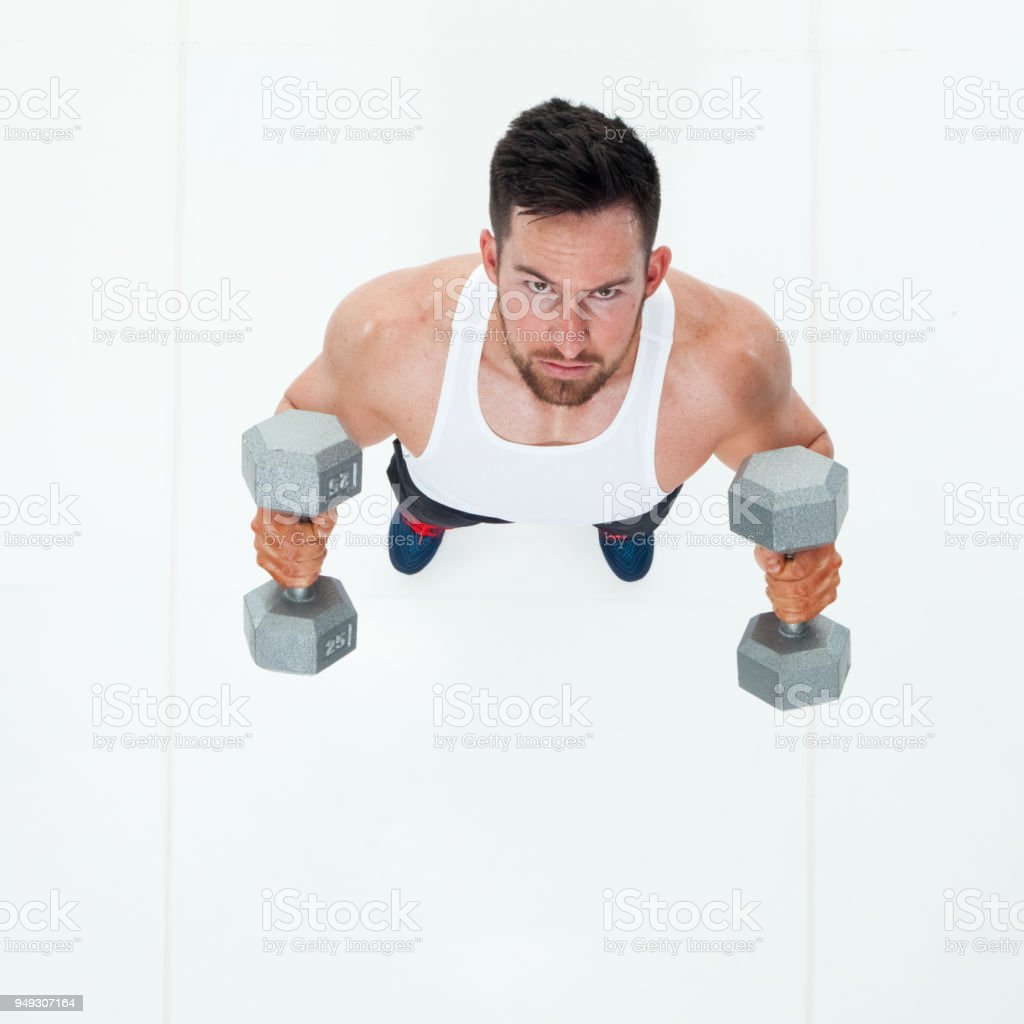 sports man using dumbbells stock photo more pictures of 20 24