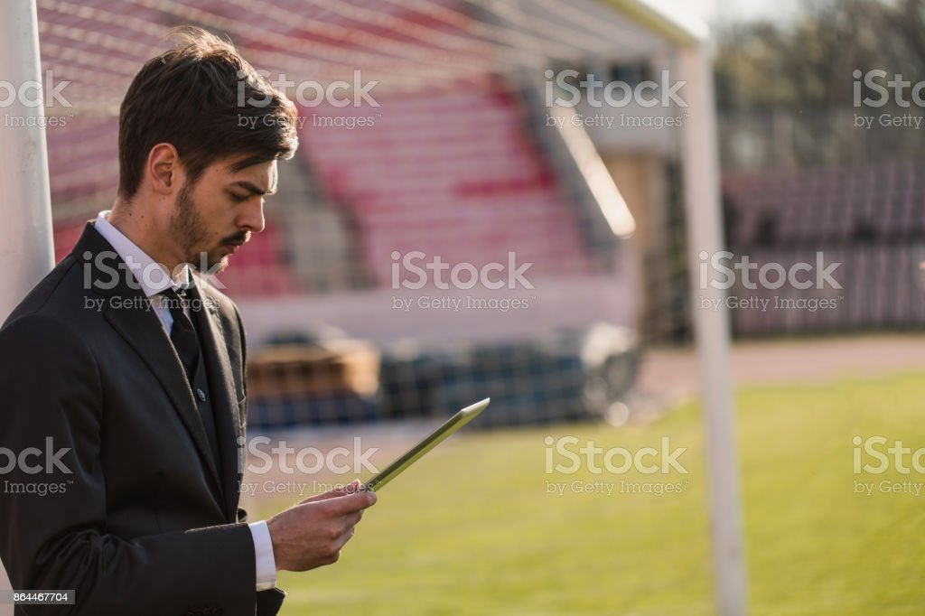 Sports manager using tablet stock photo