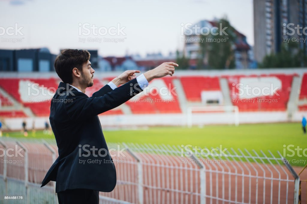 Sports manager watching game stock photo