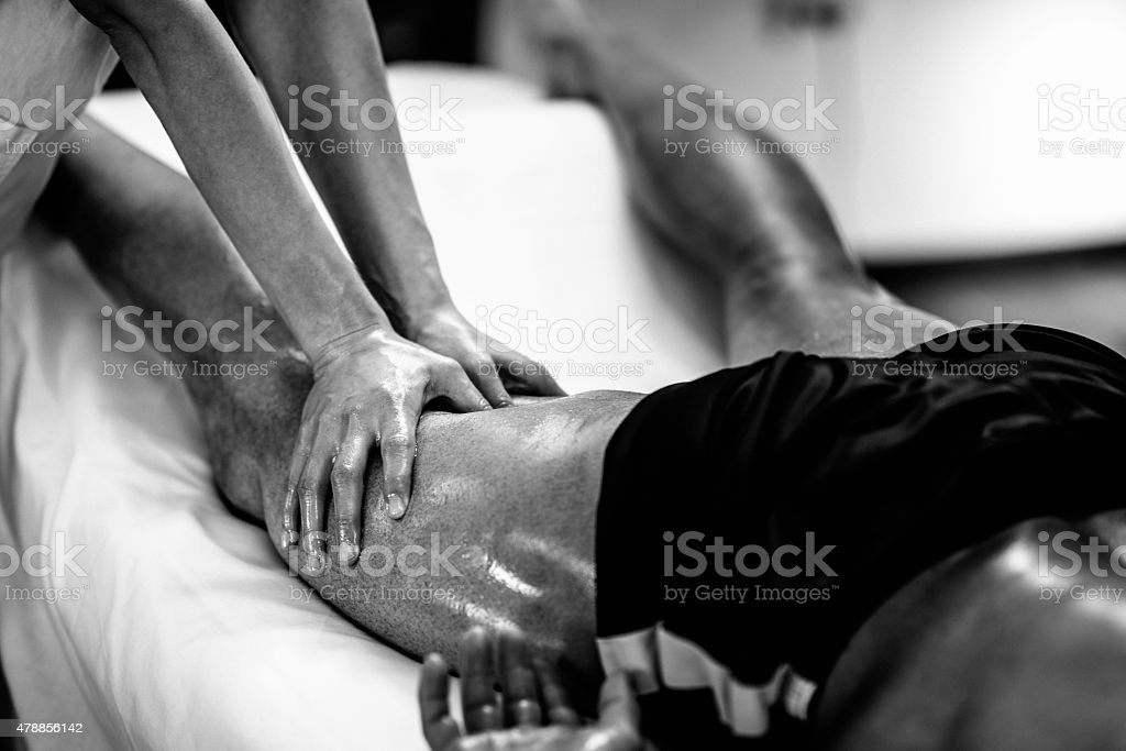 Sports massage - Massaging Legs stock photo