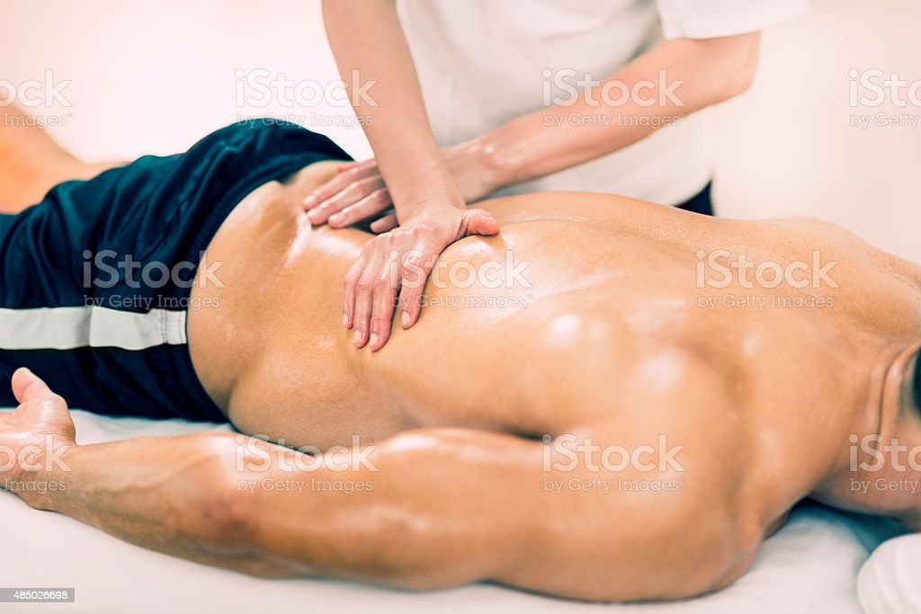 Sports Massage - Massaging Lower Back stock photo