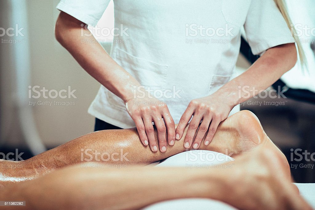 Sports massage of legs stock photo