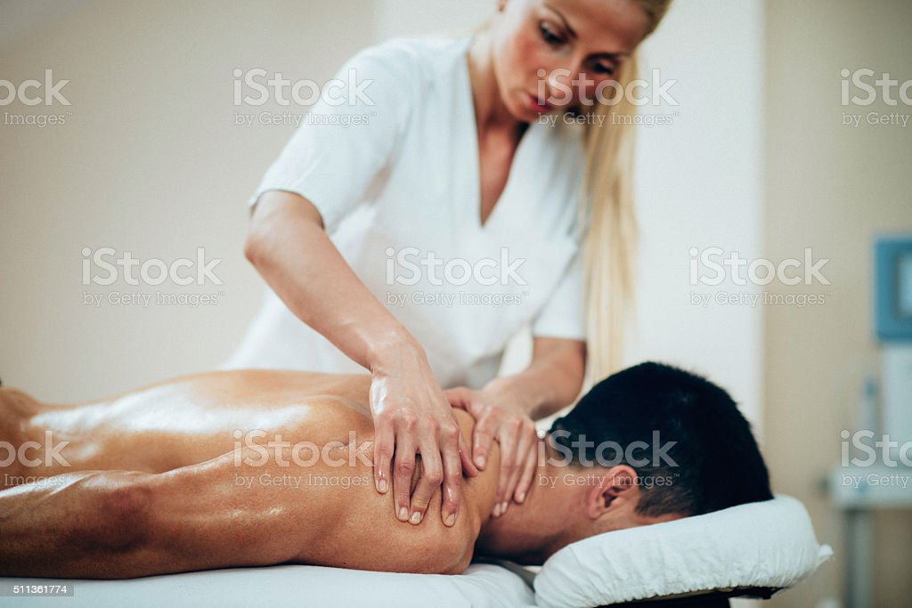 Sports massage of shoulders stock photo