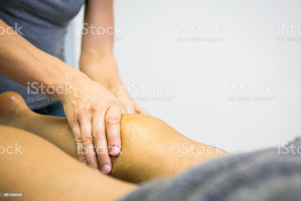 Sports massage on stiff muscles stock photo