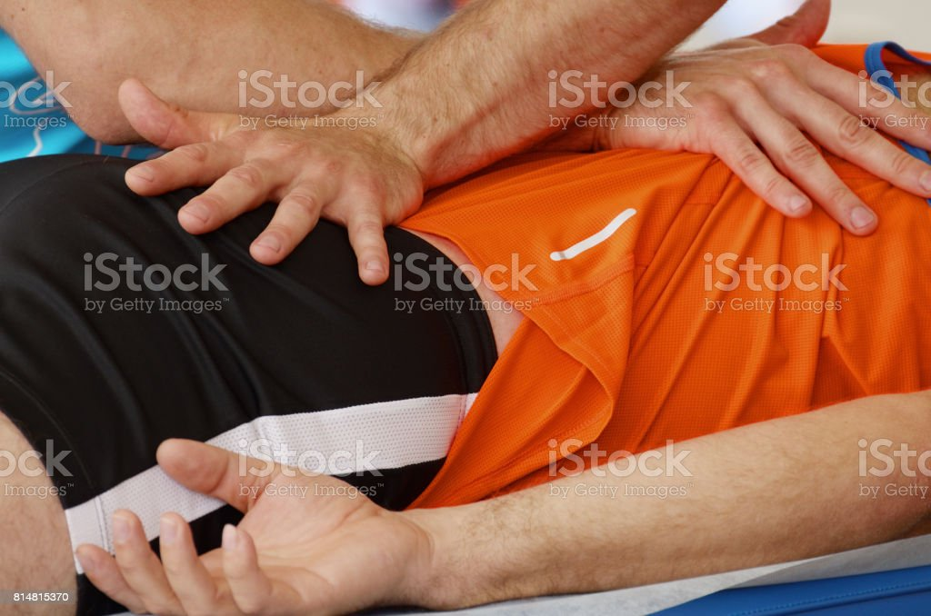 Sports massage therapists work. stock photo