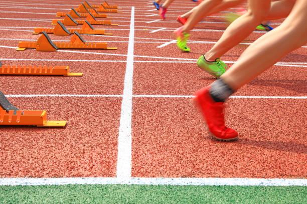 Sports meeting, the athlete sprint start stock photo