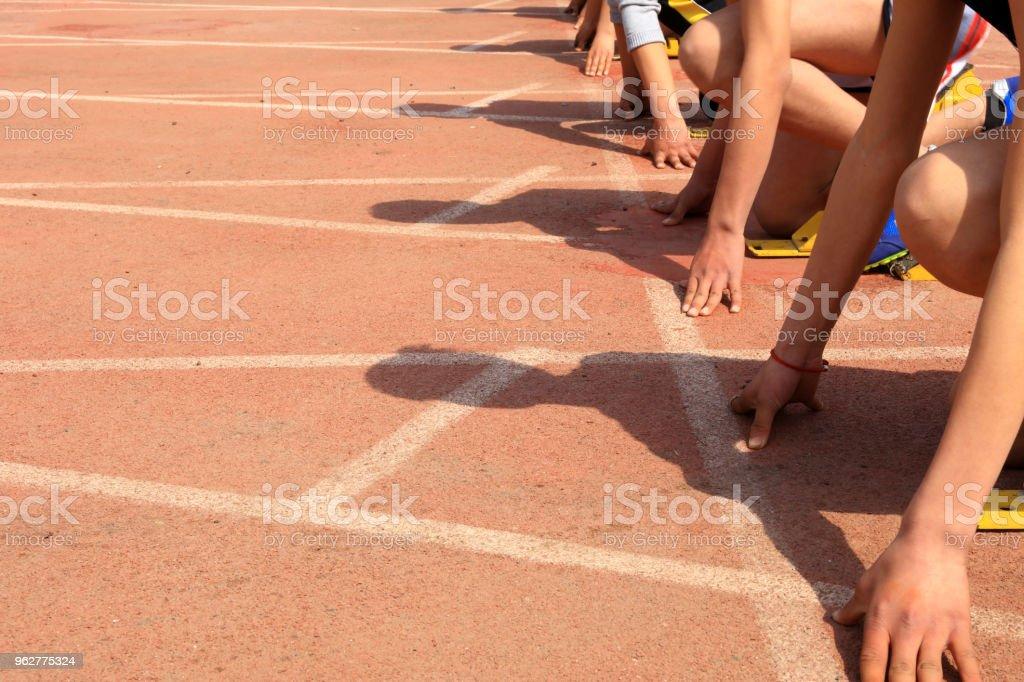 Sports meeting, the athlete sprint start - Foto stock royalty-free di Abbigliamento sportivo