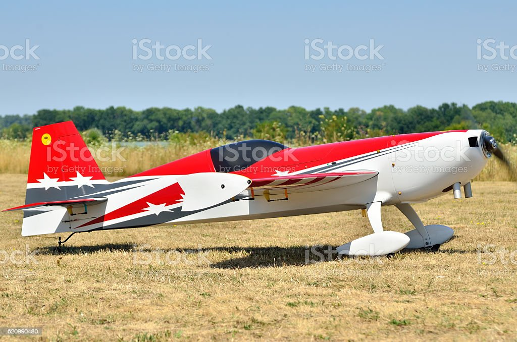 sports model aircraft takes off from airfield stock photo