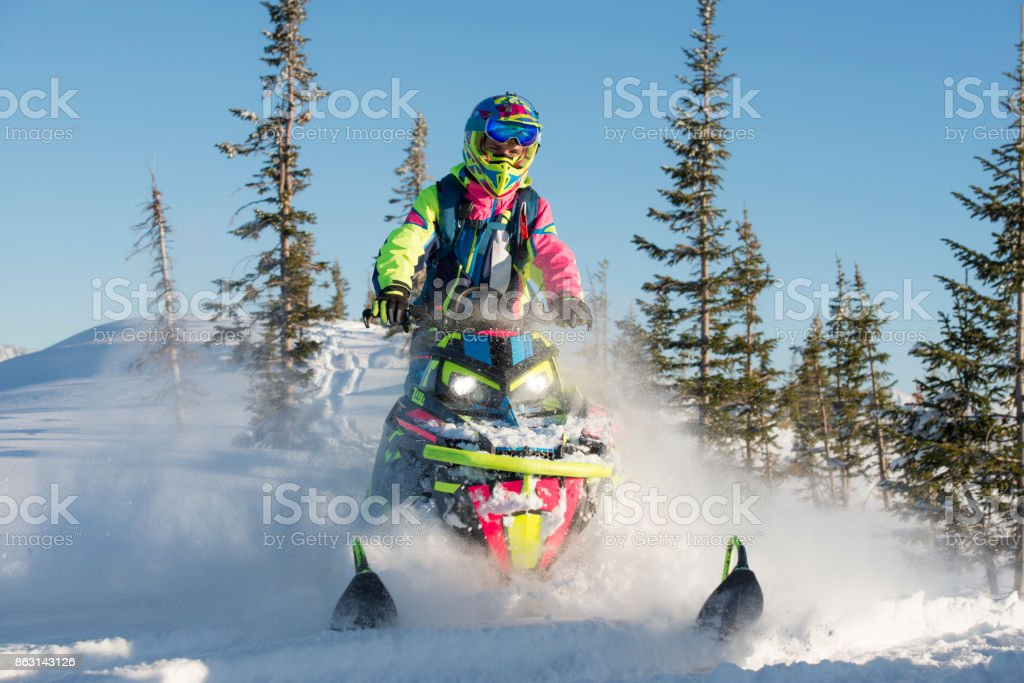 Adventure on snowmobiling in winter. Pro driver riding on an extreme...